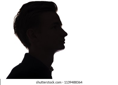 horizontal black and white silhouette of an unrecognizable guy, young man face profile on a white isolated background