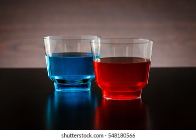 Horizontal blue and red drink in a glass focused on the red