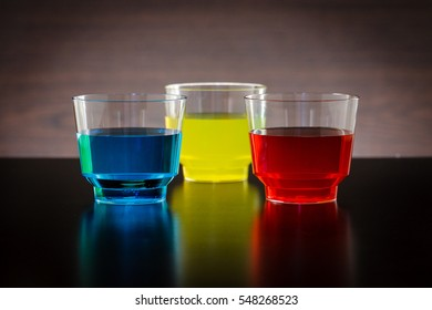 Horizontal blue, yellow and red drink in a glass