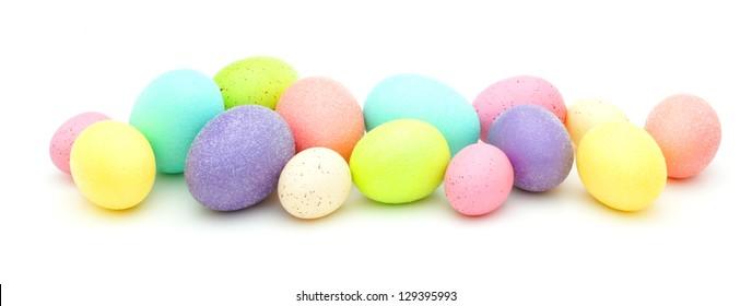 Horizontal border of colorful Easter eggs over white