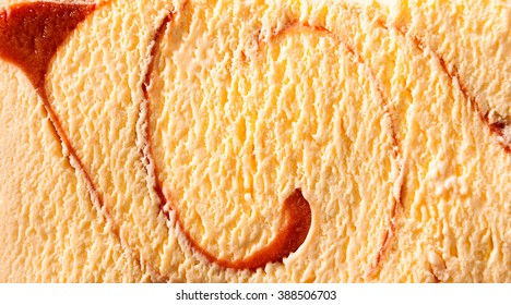 Horizontal close up of delicious creamy caramel flavor ice cream with spiral shapes inside