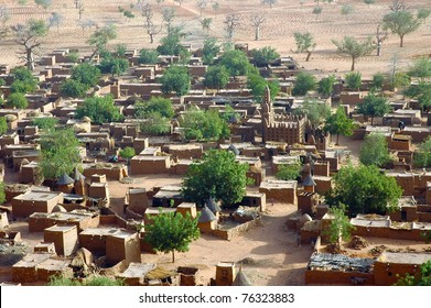 A horizontal close up of a Dogon village from below the Bandiagara cliff in Mali
