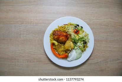 Horizontal color image taken from above of Arabian/Pakistani dish: Kabsa/Biryani (AKA Mandi Chicken Pulao)