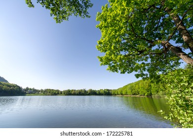 Horizontal colour image of beautiful lake surroundings