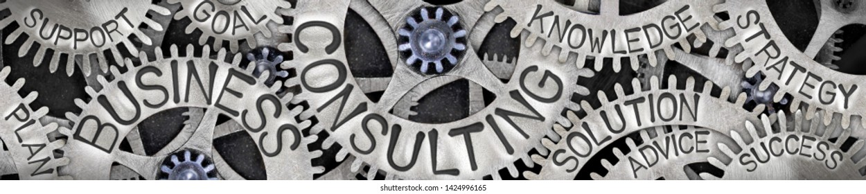 Horizontal composition of tooth wheel mechanism with Business Consulting, Advice, Goal and Solution concept related words imprinted on metal surface