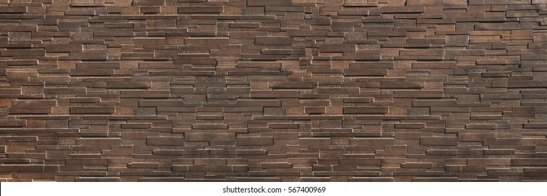 it is horizontal dark  brown brick wall for pattern and background.