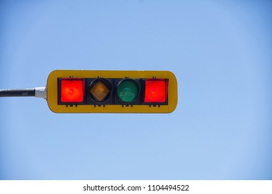 Horizontal double red traffic light against blue sky background