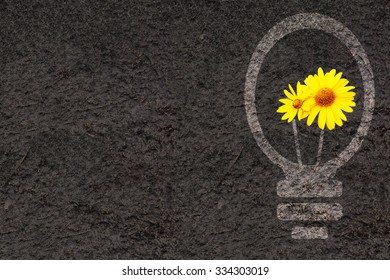 Horizontal eco background with flowers, soil and light bulb silhouette