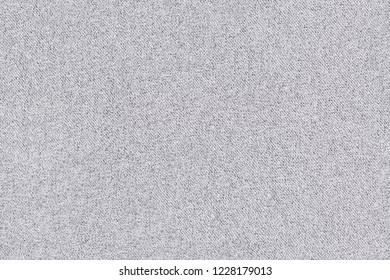 Horizontal flat lay shot of grey tweed fabric for use as seamless background and texture elements.