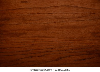 Horizontal grain medium brown pecan wood color chip can be used as background or wood grain sample.