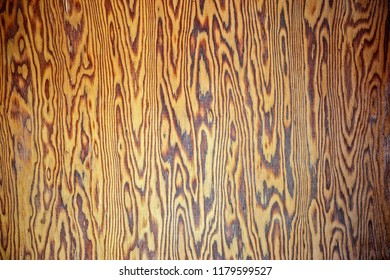 horizontal image of a blank background image of  light coloured plywood with dark grains running through it great for copy space.