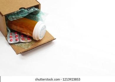 A horizontal image of a box of compounded prescription medications shipped from a mail order pharmacy (white background).  Room for text (copy)