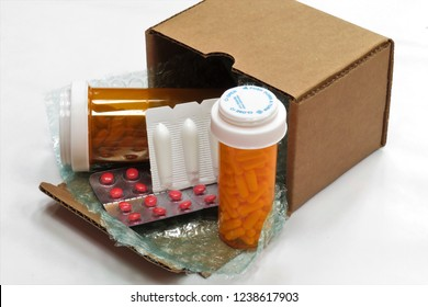 Horizontal image of a box of compounded prescription medications shipped from a mail order pharmacy (with a white background).