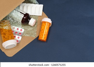 Horizontal image of a box of compounded prescription medications shipped from a mail order pharmacy on a blue background with room for copy (text)