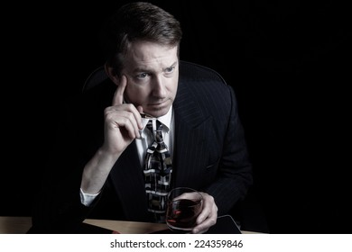Horizontal image of business man working late with black background