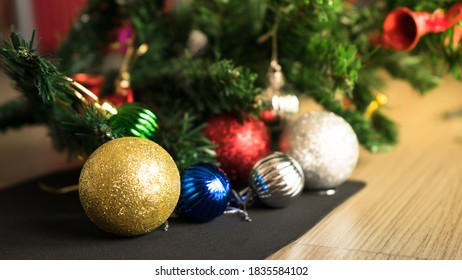 Horizontal image close up and selective focus red wrinkle Christmas ball hanging on Christmas tree for celebrate