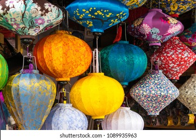 Horizontal image of colorful paper lanterns in a shop in Hoi An, Vietnam