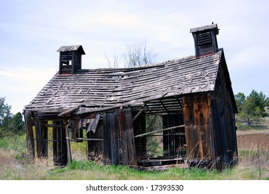 Horizontal image of a derelict 1900's barn in ruins, in Oregon, USA.