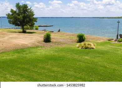 Horizontal Image is Example of Difference Watering a Lawn Makes. One is watered the other not.