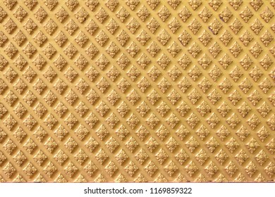 """Horizontal image of golden Thai pattern background.Antique Thai stucco pattern or """"Lai Thai"""" for vintage abstract background concept."""