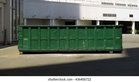 Horizontal image of green dumpster used for large amounts of trash