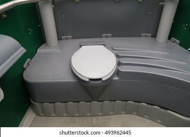 Horizontal image of the Interior of portable toilet featuring the toilet seat.