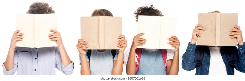 horizontal image of multicultural schoolgirls and schoolboys covering faces with books isolated on white