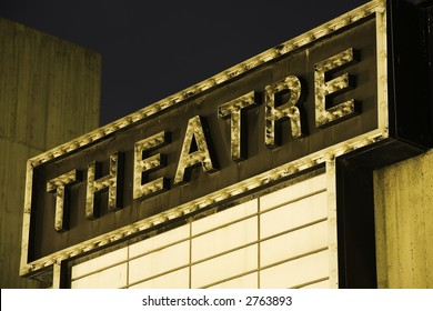 Horizontal image of an old Theatre Marquee.  Evening shot.