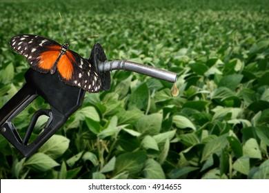 horizontal image of orange butterfly on gasonline nozzle