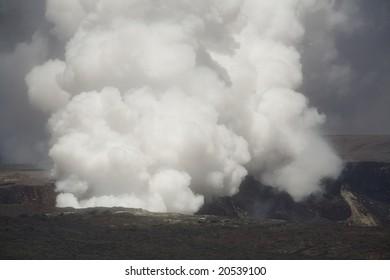 Horizontal image of the smoking caldera of the Kilauea volcano on Hawai'i (Big Island), a shield volcano.