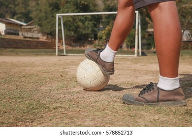 Horizontal image of soccer ball with foot of player kicking it.selective focus