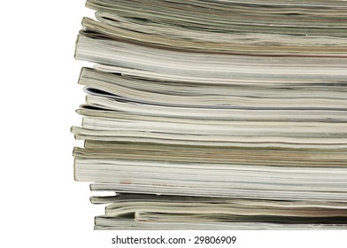 Horizontal image of the spine and ends of a stacked pile of magazines.