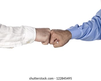 Horizontal image of two hands of businessmen having a fist bumping
