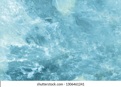 Horizontal lightened slices of blue marble quartz ice background. Cold calm colors icy background ideal for your design