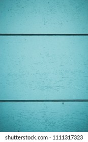 Horizontal lines on blue empty panels. Texture made of blue wood strips. Graphic resource. Space for text.