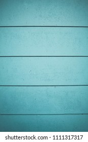 Horizontal lines on blue pastel empty panels. Texture made of blue wood strips. Graphic resource. Space for text.