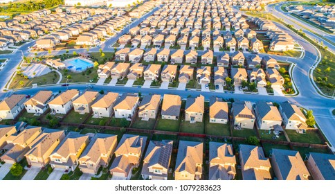 Horizontal Lines Suburb housing neighborhood Homes in suburbia - aerial drone view - above Austin , Texas , USA perfect cubed square houses living area in real estate suburban community at sunset