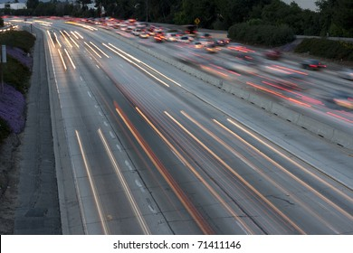Horizontal long exposure image of the 405 Freeway in Los Angeles in the early evening.