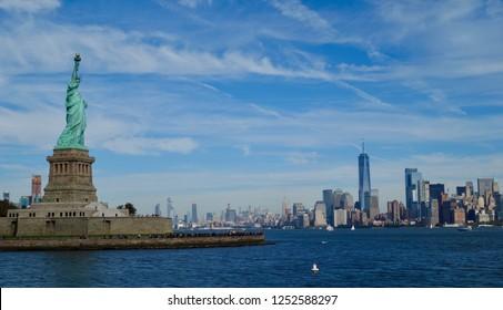 Horizontal long shot of statue of liberty and manhattan skyline