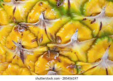 Horizontal macro textured background of fresh pineapple