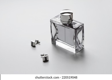 Horizontal mens cologne and cuff links monochrome