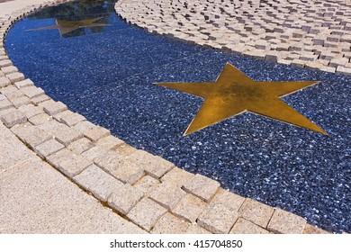 Horizontal metal stars path on marble design