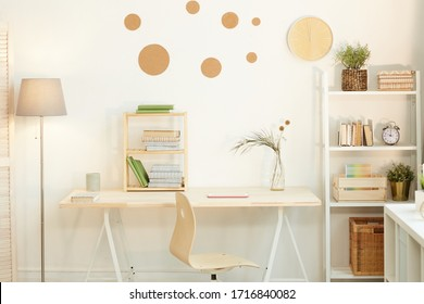 Horizontal no people shot of minimalistic workspace interior in room belonging to young person