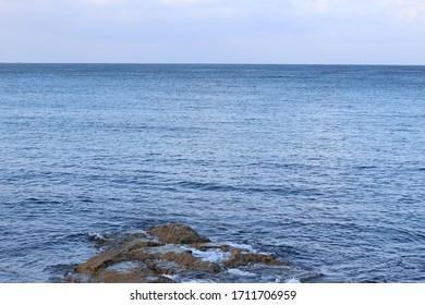horizontal ocean view, rock and sky
