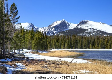 horizontal orientation color image of Bierstadt Lake, Rocky Mountain National Park, Colorado, USA in Spring, with snow covered mountains and terrain / Bierstadt Lake, Rocky Mountain National Park, CO