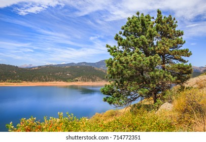 horizontal orientation color image of Carter Lake in Loveland, Colorado, USA with wispy clouds and blue skies / Carter Lake in Loveland, Colorado, USA