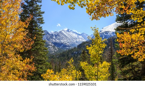 Horizontal orientation color image of fall leaves framing rugged mountains at Rocky Mountain National Park, Colorado