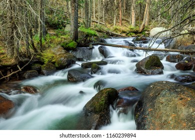 Horizontal orientation color image with long exposure of waterfalls in the Indian Peaks Wilderness area of Colorado, USA