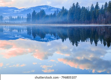 Horizontal orientation color image of McArthur Lake in northern Idaho at sunset on a cloudy night