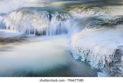 Horizontal orientation color image of waterfalls in Boulder Canyon, Colorado in winter, taken with a long shutter speed